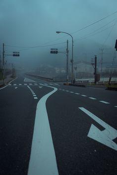 but an empty street, a foggy day.