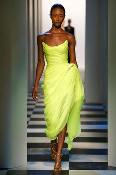Oscar de la Renta sent a shock of color down the runway with this neon lime confection during New York Fashion Week.