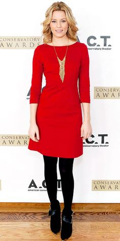 Elizabeth Banks in red 3/4 sleeve dress with black tights and booties