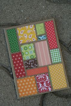 handmade card ... quilt appearance ... kraft base ,,, cut your scraps into rectangles ... adhere close but leave space between ... draw stitching lines inbetween the units ... lovely creation ...