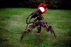 Metal Spider Garden Floor Lamp #Floorlamp #Handmadelighting #Lamp #Lighting #Lightingdesign #Metallic #Outdoorlighting #Recycle #Steampunk