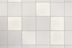 Patchwork of porcelain tex-tiles, with lights on/off #tiles #transparant #white #translucent #porcelain #15x15 #bathroom #textiles #wall #decoration #led #imprint #relief #barbaravos #wallcovering #kitchen #shower #home #interior #design #glaze #backsplash #flower #pattern #coral #fabric #lace #backlit