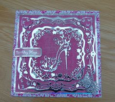 Birthday card using tattered lace embossing folder,tattered lace shoe die & couture dies from create and craft, plus butterfly embellishments on a stamped background.