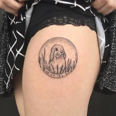 Simple bunny tattoo on leg