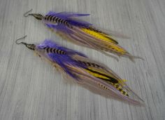Excellent, extra long feather earrings in grey, purple, and yellow.  Perfect for LSU Tiger fans or simply for anyone who loves boho style earrings! Handmade by @litvas_jewelry Available at https://www.etsy.com/listing/251918916 #feather #jewelry #earrings #handmade #grey #purple #yellow #lsu #tigers #lsutigers #geauxtigers #boho #bohojewelry #handmadejewelry #etsy #etsyhandmade #etsyhunter #etsynch #love #litvasjewelry #jeweler #shop #shopsmall