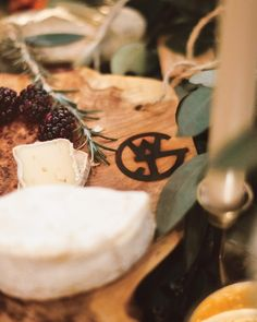 Custom cheese boards at a wedding cocktail hour.