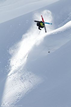 Sammy Carlson send a cork 720 off a small wind lip in the Whistler backcountry.