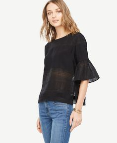 """Sheer stripes add polished peek-a-boo to this airy blouse, finished with feminine flounce sleeves. Add a cami beneath for more coverage. Jewel neck. Elbow flounce sleeves. Back keyhole with button closure. Side slits. 22 3/4"""" long."""