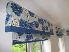 Pelmets and matching roman blinds in a blue floral print with plain blue contrast borders.  Made by Beechwood Curtain Design