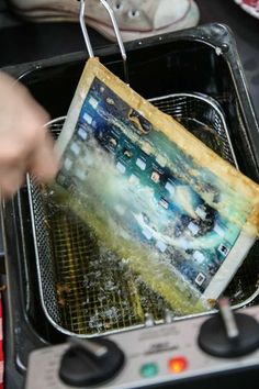 Deep Frying an Ipad. Somehow it is quite a painful image to look at. by Henry Hargreaves