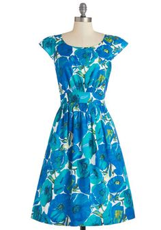 With a cotton lining, secret pockets, and fluttery cap sleeves, this keyhole-closed dress is a treat in and of itself!