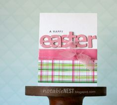 The plaid on this handmade Easter card has been stamped with pink and green colors, but you could also use a fun spring paper scrap! Follow the tutorial if you want to do the stamping.