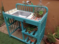 Baby bed or changing table turned into a potting bench