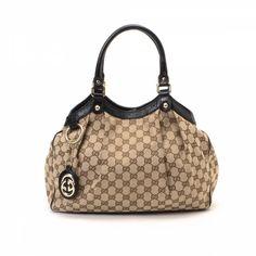 37d32bcb658 LXRandCo guarantees this is an authentic vintage Gucci Sukey Tote Bag  handbag.