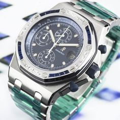 ⌚Special Edition Sapphires⌚  #AudemarsPiguet #RoyalOak Offshore #Chronograph ref. #25862SC.ZS.10000ST.02 in stainless steel. Featuring an 18k white gold bezel set with 16 baguette cut #diamonds and 16 baguette cut #sapphires.  This is not a #watch seen very often as it is a limited production.  Complete with box, papers and service papers dated February 2017, service stickers still attached.