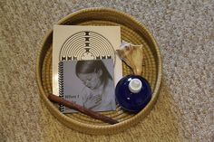 """Peace Basket for when somebody needs some quiet, alone time.  Contains a whelk shell for the girls to hold up to their ears to hear the ocean (they have to be very still and quiet to hear the sounds of the """"waves""""), a fingerlabyrinthto trace, a cinnamon stick to smell, a book to read (When I Make Silence by Jennifer Howard), and our Starry Night Bottle to shake and then watch the """"stars"""" settle to the bottom."""