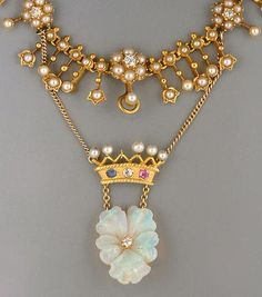 An Edwardian seed peal necklace. The front section set with a seed pearl and old brilliant-cut diamond fringe, suspending a gem-set crown and foliate pendant.