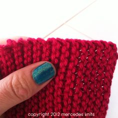 How to pick up stitches on garter stitch edge.  Forget the tedious task of one at a time, put them on all at once.