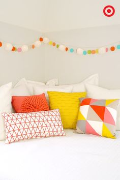 A mix of color, texture and print can be just as fun as unicorns and spaceships! Mix and match your pillows—coral, yellow and salmon are all the rage for Spring!