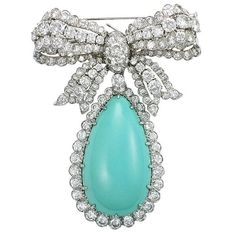 David Webb turquoise & diamond drop broach in platinum with over 9 carats in G color VS clarity diamonds.