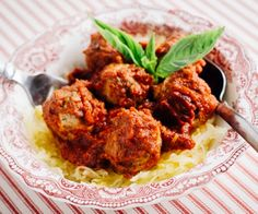 Tender chicken meatballs, fragrant with pesto and simmered in a quick-and-easy, tomato-basil sauce.