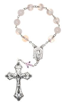 "Rose Quartz Pocket Rosary - Gift Idea. Hand Crafted in the USA - One (1) Decade Pocket Rosary. Approx 8mm Rose Quartz Gemstones;  Swarovski Crystal - Lord's Prayer. Silver plate Crucifix & Center - may vary.**. Includes gemstone meaning. The Rose Quartz is the stone of ""gentle love"", bringing peacefulness and calm."