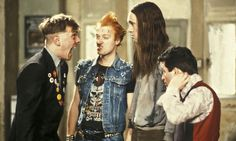 Rik Mayall as Rick in the Young Ones with Adrian Edmondson as Vyvyan, Nigel Planer as Neil, and Christopher Ryan as Mike. Photograph:...