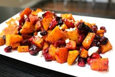 I love roasting winter squash. I normally keep it simple, but I saw this roasted butternut squash recipe that had cranberries and feta {one of my favorite combos} and I thought, what the heck. I'll give it a try. I had never had that combination before but...