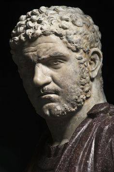 Portrait of Caracalla, marble, Roman, 215-217CE. Emperor between 198 and his assassination in 217 he had himself depicted with a soldier's short hair and a menacing scowl that he delighted in. Remembered for his vicious nature he was also responsible for granting citizenship to all free men in the empire and building the baths in Rome that bear his name.