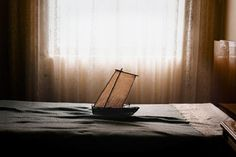 Ara Solis, sails ships across seas of crumpled bed sheets. Then he takes a picture.