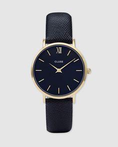 Reloj cuarzo 2 agujas, caja de color oro amarillo y tapa trasera de acero, esfera azul noche y correa de piel azul noche con acabado safiano.