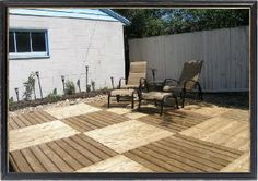 Outdoor decking comprised of recycled pallets.