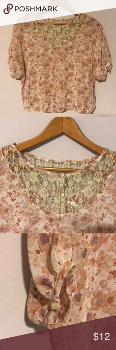 Floral and Lace Top Super sweet floral Top with capped sleeves. The lace detail around the neck gives shirt a dainty and vintage feel. Sides and sleeves button shut! 100% polyester, brand is Kimchi Blur from Urban Outfitters! Worn twice but too small for me now! Urban Outfitters Tops Blouses