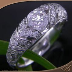Very similar to my ring - love the antique style.  Greenlake Jewelry Works does amazing work!