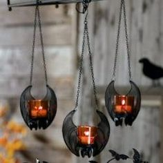 hanging bats holding votive candles... really cute!                                                                                                                                                                                 More
