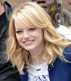 The Best Emma Stone Hairstyles: Emma Stone With Sideswept Blonde Bangs