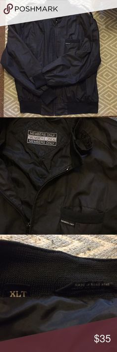 Black Members Only Bomber Jacket, Men's XL This jacket has been worn but is in great condition; some loose threads but no visible tears or stains.   Features a zipper closure with a snap closure over the collar and elastic on the cuffs and waistband. Members Only Jackets & Coats Bomber & Varsity