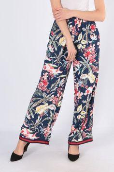 d114c3b58352 Tmavomodré kvetované dámske nohavice s pásikom