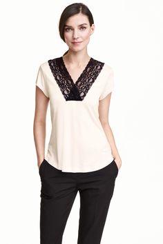 Camiseta con encaje punto suave                                                                                                                                                                                 Más