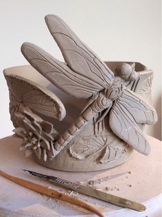 New design just made. Dragonfly yarn bowl with a water lily and three lily pads. The yarn feed can be seen on the left of the Dragonfly. There is sharpening up still to do on this with brush and...