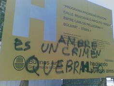 """""""H"""" campaign by Macri in Buenos Aires. Message sprayed on top: """"Hambre es un crimen"""", Hunger is a crime."""