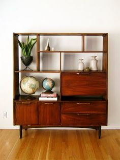 mid century modern - I own this. It is perfect in my dining room. The lower left cabinet holds my wine in a little rack and the upper right holds the bar. The little slot on the right hand corner above the drawers is perfect for the Phaidon atlas of architecture my friends got me years ago. Love it!
