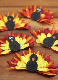 "Create silk flower turkeys for Thanksgiving! These make super cute additions to napkin rings or place cards! Just remember - spare your fingers from being burned and use Glue Dots instead! Micro Glue Dots for the orange nose, Mini Glue Dots for the body and 1"" Glue Lines to hold the petals together! No mess, no burns, no dry time = more family time."