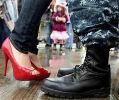 Celia Codd's flashy red heels contrast against her husband Miguel's work boots as the two embrace after the USS Connecticut docked at Naval Base Kitsap-Bremerton in Bremerton, WA on Wednesday, April 27, 2011. More than 140 sailors returned aboard the Navy submarine after taking part in exercises below the Arctic ice. (MEEGAN M. REID/KITSAP SUN)