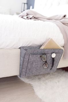 Bedside caddy / Storage solutions / Bedside table replacement / Small bedroom / Bedroom decor / Home decor / Storage solutions / Bedroom inspiration / Bedroom storage solutions / Bedside pocket / Books holder / Storage for books Bedside Caddy, Bedside Organizer, Bedside Storage, Diy Storage, Storage Hacks, Small Storage, Storage Design, Table Storage, Jewelry Storage