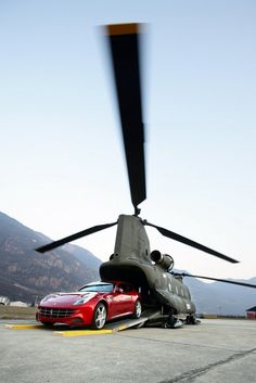 Ferrari FF: Ferrari FF being loaded into Chinook. Photography by: Ferrari S. >> Available in Cote d'Azur, French Alps and Paris! Luxury Sports Cars, Alfa Romeo, Jorge Martinez, Cool Pictures, Cool Photos, F12 Berlinetta, Saint Emilion, Parking, Photos Of The Week