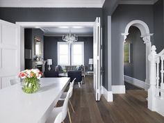 Love the grey walls, white trim with the dark wood floors Living-Room-Greg-Natale's-Payne-House - modern yet totally timeless. The dark grey walls allow those white accents to be a part of the rooms interiors, without any interference. Each design ele Grey Wall Color, Color Yellow, Blue Yellow, Color Black, Dark Wood Floors, Dark Hardwood, Open Plan Living, Open Plan Kitchen Living Room, Home Fashion
