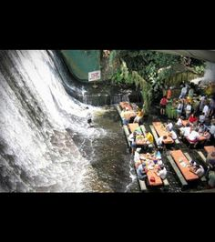 Restaurant at the base of a waterfall in the Philippines
