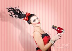 Pin-up portrait of a brunette fashion model with long straight hair blow drying with retro hairdryer. Hair care concept by Ryan Jorgensen