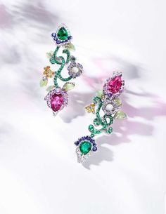 Fabergé earrings from the new Secret Garden high jewellery collection. The new Secret Garden collection of Fabergé jewellery looks to delight with the unexpected. Leaves carved from Siberian jade unfurl alongside hot pink sapphires and deep red spinels, entwined by delicate gold tendrils set with a trail of graduated Colombian emeralds.